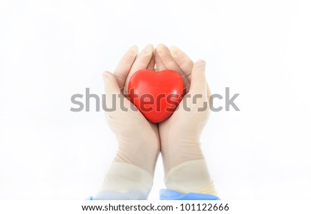 stress reliever foam ball with the shape of an heart hold by female hands in sterile gloves
