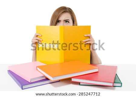 Stressed Asian student girl behind science text book - stock photo