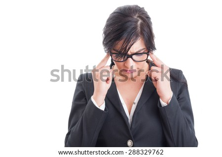Stressed business woman having a headache and massaging or pressing temples