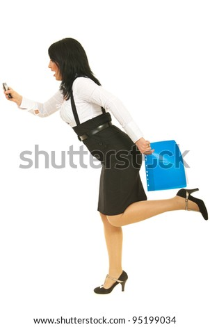 Stressed business woman  in a hurry holding phone mobile , folders and  being surprised of her late isolated on white background