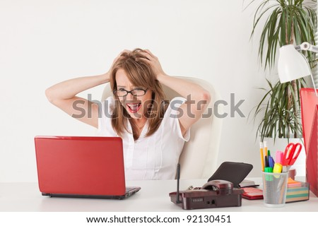 Stressed  business woman with  laptop in the office. - stock photo