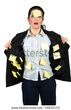 Stressed business woman with many yellow notes on her suit and one on her face - stock photo