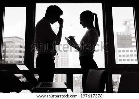 Stressed businessman and businesswoman at the office. - stock photo