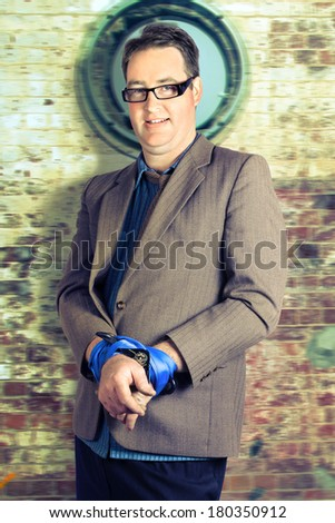 Stressed businessman bound with hand ties when a prisoner to a corporate career - stock photo