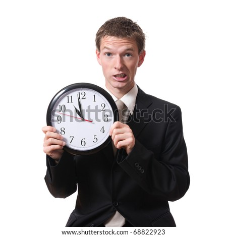 stressed businessman holding a clock isolated on white background - stock photo