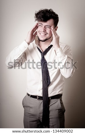 stressed businessman on gray background