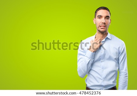 Stressed businessman on green background