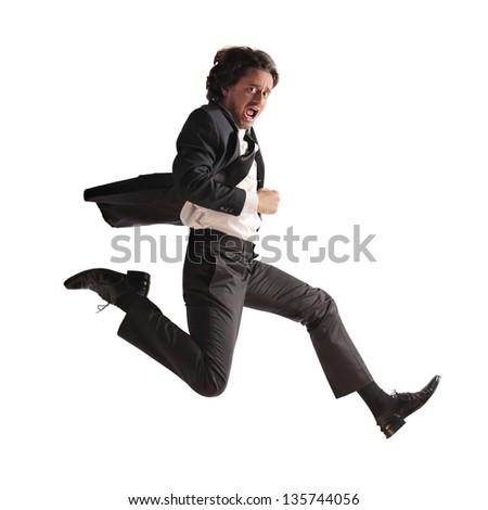 stressed businessman runs - stock photo