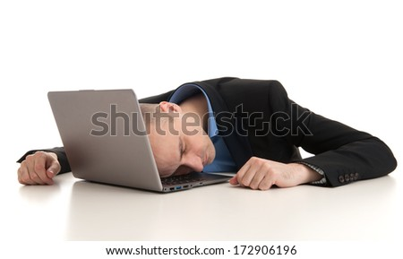 stressed businessman sleeping on a laptop. Studio shot - stock photo