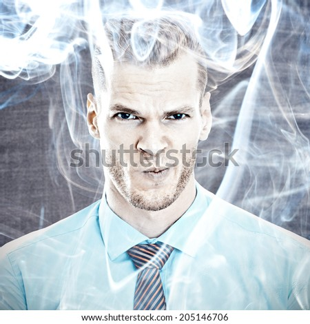 Stressed businessman with smoke in head  - stock photo
