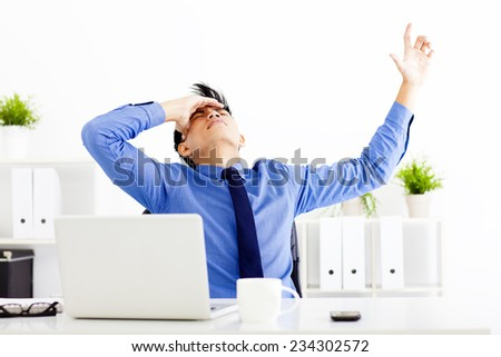 stressed businessman working in the office - stock photo