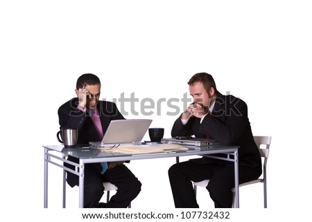 Stressed Businessmen in an Office Working Together - Isolated Background - stock photo