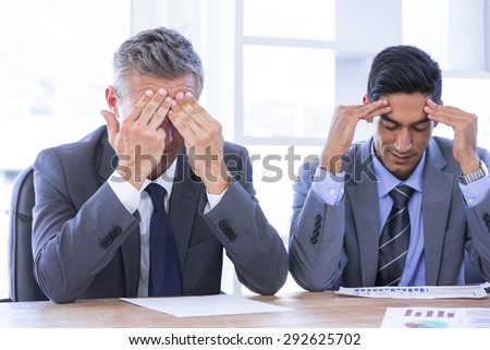 stressed businesspeople in the office - stock photo