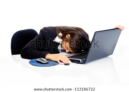 Stressed businesswoman is frustrated and overworked at her desk and computer isolated on white background