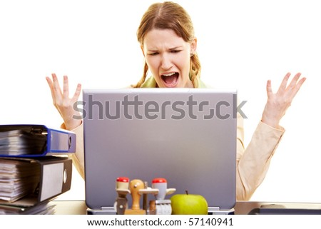 Stressed businesswoman shouting loudly at her laptop - stock photo