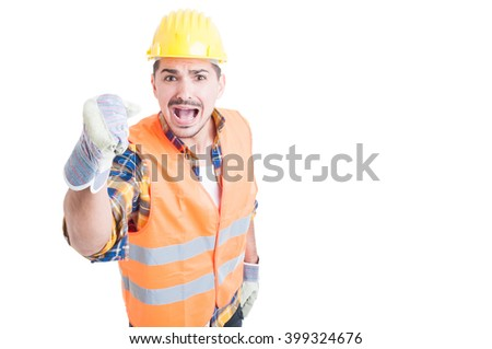 Stressed constructor yelling and standing with fist up with copypaste on white background - stock photo