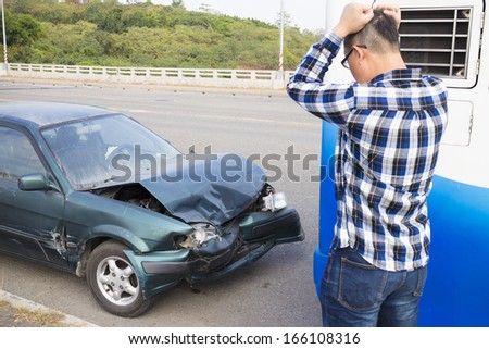 Stressed Driver looking the car After Traffic Accident - stock photo
