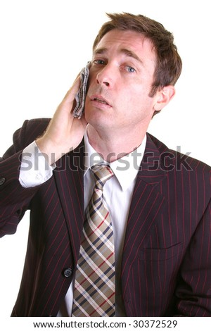 stressed executive holding handkerchief to his face - stock photo