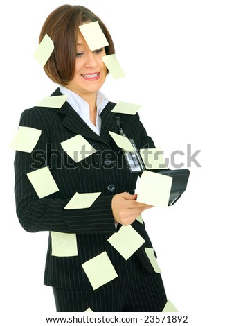 stressed female accountant holding calculator has many empty post it note on her suit - stock photo