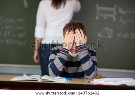 Stressed male student can't cope anymore during class - stock photo