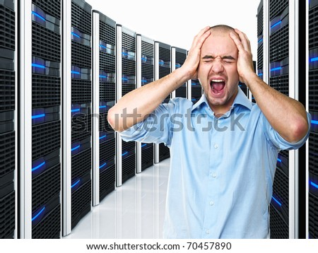 stressed man and datacenter with lots of server - stock photo