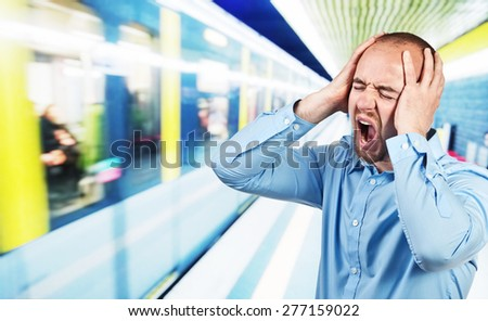 stressed man and  urban train - stock photo