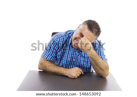 Stressed man at the office, desperate gesture,  head leaning to the left, left hand holding the forehead, isolated on white, studio shoot. - stock photo