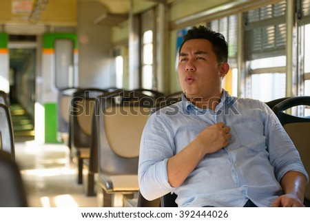 Stressed man traveling with train