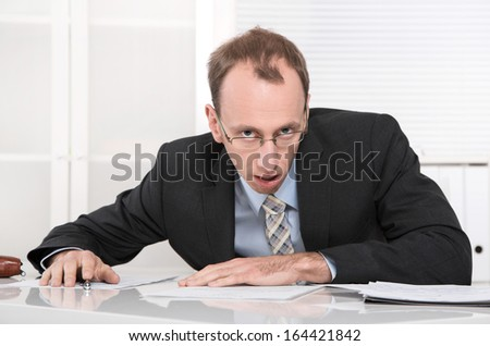 Stressed manager with crisis sitting at desk. - stock photo