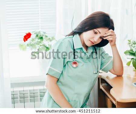 Stressed medical doctor woman in office . nurse - stock photo