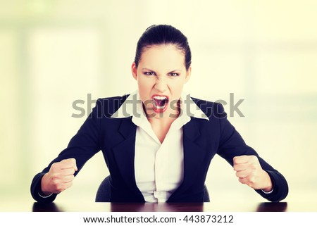 Stressed or angry businesswoman screaming - stock photo