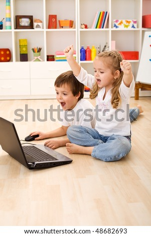 Stressed or excited kids about to win computer game - stock photo