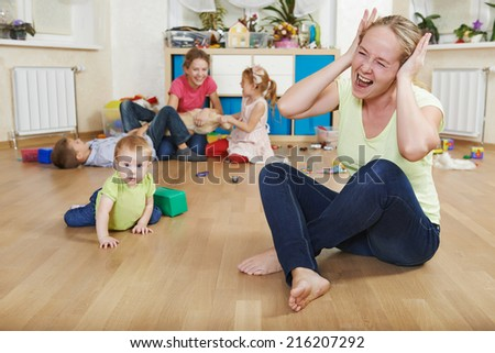 stressed or frustrated mother in depression from children behaviour - stock photo