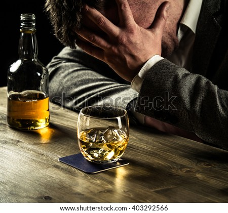 Stressed out businessman drinking whiskey