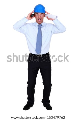 Stressed out engineer - stock photo