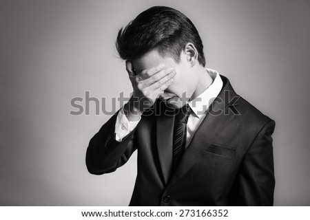 Stressed out man in suit. - stock photo