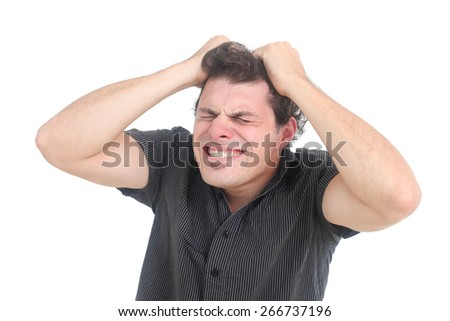 stressed out man pulling his hair on a white background