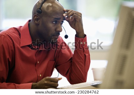 Stressed Out Man with Headset - stock photo
