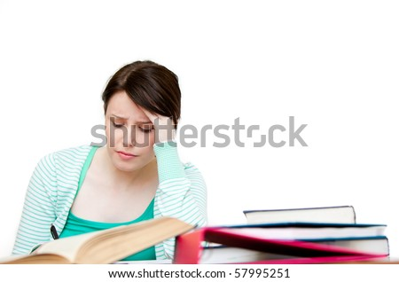 Stressed student doing her homework against white background - stock photo