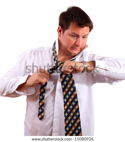 Stressed up office worker or a businessman late for work looking at his watch - stock photo