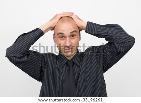 stressed young business man - stock photo