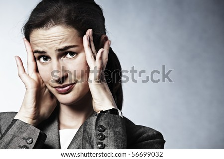 Stressed young business woman having headache. - stock photo