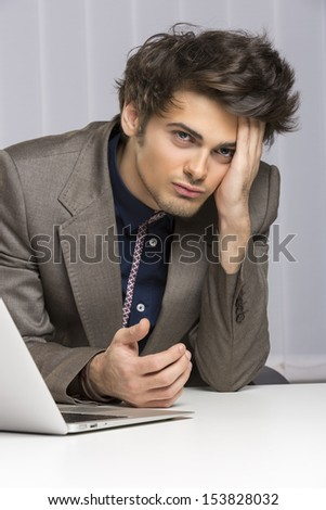 Stressed young businessman showing an attitude of failure, disappointment at work. Banking, insurance, law, sales. - stock photo