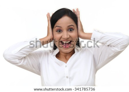 Stressed young businesswoman against white background - stock photo