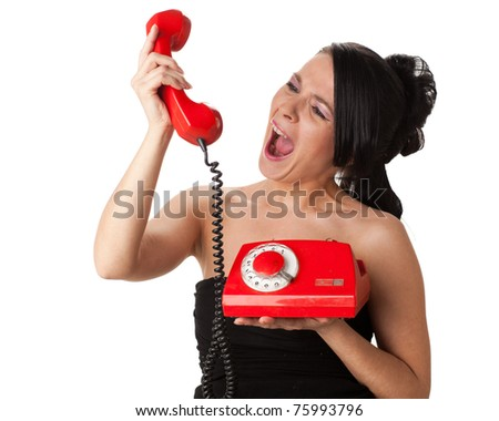 Stressed  young businesswoman with telephones in her hands. - stock photo