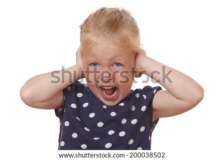 Stressed young girl covers ears with hands on white background - stock photo