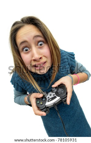 Stressed young girl playing console games - stock photo