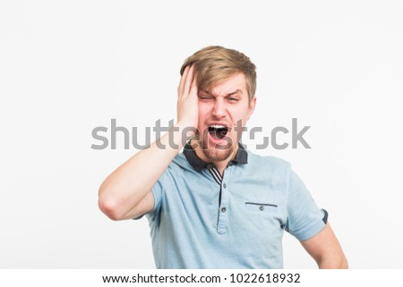 Stressed Young Man Clutching Head