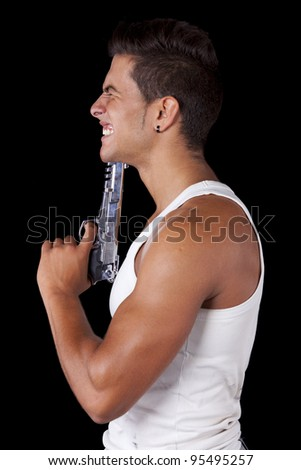 Stressed young man with a gun pointing to his head (isolated on black)