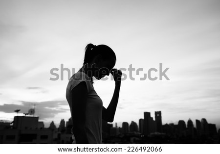 Stressed young woman - stock photo